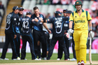 Shane Watson (R) of Australia walks back to the pavillion after being icaught behind by wicketkeeper Luke Ronchi off the bowling of Mitchell McClenaghan of New Zealand. Photo / Getty Images.