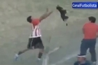 An Argentine footballer takes a dog by the neck and throws him to the stands. The dog crashes into the fence and runs across the field of play. The poor dog suffers an attack and the player is ejected. Courtesy: CanalFutbolista.com