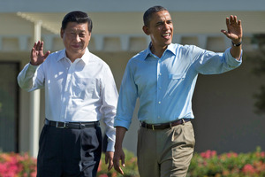 President Barack Obama and Chinese President Xi Jinping, left, walk at the Annenberg Retreat of the Sunnylands estate. Photo / AP