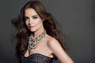 Katie Holmes smokes it up in this shoot for Bobbi Brown, featuring a blinged-up black dress.
