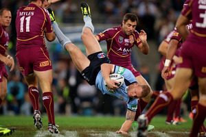Luke Lewis of the Blues is up-ended in a tackle during game one of the ARL State of Origin series. Photo / Getty Images