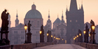 The sun rises over Prague's historic Charles Bridge, which was constructed in the 15th century. Photo/Getty Images