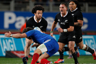 All Black centre Rene Ranger about to bump off Yoann Huget. The French fullback came off second best and was injured in the attempted tackle. Photo / Richard Robinson