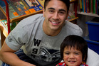 Warriors player Shaun Johnson says being able to do something positive for children like 3-year-old Gideon Fe'ao is a great feeling. Photo / Sarah Ivey