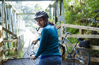 Nadia Lim crosses the Karangahake River on a bicycle on the Hauraki Rail Trail. Photo / Carlos Bagrie