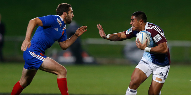 Blues centre Malakai Fekitoa, right, in action during the rugby match against France. Photo / Brett Phibbs