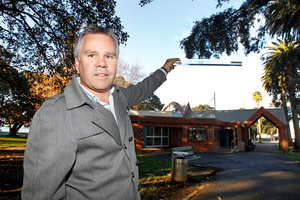 Tony Koia demonstrates the height of the proposed library building. Photo / Chris Gorman