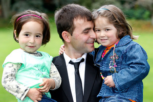 Hussain Sayed with daughters Zakia, 4, (left) and Madina, 5, were welcomed to New Zealand at Government House yesterday. Photo / Chris Gorman