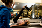 The Reformer Pilates machine makes seldom-used muscles wake up and go to work, improving flexibility as well as strength. Photo / Michael Craig
