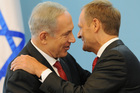 Israeli Prime Minister Benjamin Netanyahu, left, and his Polish counterpart Donald Tusk hug each other after a press conference in Warsaw, Poland. Photo / AP