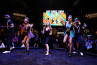 McKayla Maroney, center, plays 'Just Dance 2014' at the Ubisoft booth at E3. Photo / AP