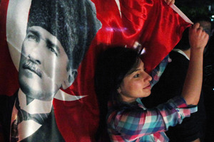 One of thousands of Turkish protesters, holding national flags and portraits of Turkey's founder Mustafa Kemal Ataturk. Photo / AP