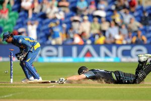 New Zealand batsman Mitchell McClenaghan scampers home for a close-run two to nail the win over Sri Lanka.  Photo / AP