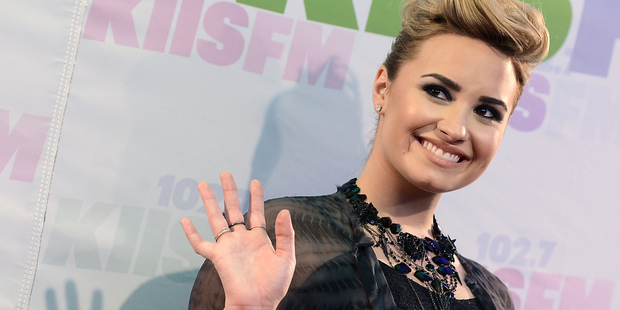 Demi Lovato wants a Barbie doll that looks just like her, cellulite and all. Photo / AP
