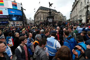 Protesters gather in Piccadilly Circus to demonstrate against the G8 meeting set for Northern Ireland next week. Photo / AP