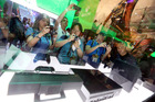 E3 2013 attendees interact with Xbox One at Microsoft's booth at E3 2013 in Los Angeles. Photo / AP