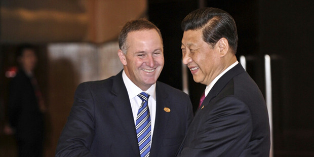 Prime Minister John Key with Chinese Premier President Xi Jinping. China has been clear the special relationship status New Zealand enjoys comes with obligations. Photo / Supplied