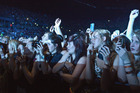 Fans of Ed Sheeran raise their phones and cameras as he performs in concert at Vector Arena, Auckland. Photo / Herald on Sunday