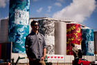 Graffiti artist Askew One, aka Elliot O'Donnell, with his latest work done on the tanks at Wynyard Quarter. Photo / Dean Purcell