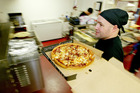 Spending at takeaway outlets, like Hell Pizza seen here, was up more than 11 per cent last month compared to a year ago. Photo / Martin Sykes