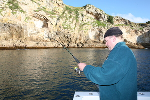 Greg McKinney boats a snapper on soft bait tackle. Photo / Geoff Thomas