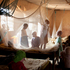 Children play under mosquito netting inside a dormitory of the Kabanga Protectorate Center, housed in a walled compound for the Kabanga Primary School. Photo / AP