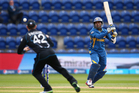 Dilshan Tilakarathne of Sri Lanka hits to the offside as Brendon McCullum of New Zealand fields. Photo / Getty Images