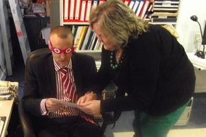 Julie Woods teaches David Clark to read braille. Photo / APNZ
