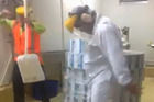 The men and other employees re-enacted their version of the Harlem Shake at Fonterra's Takanini plant. Image / YouTube