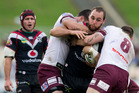 Warriors captain Simon Mannering is wrapped up by Manly Sea Eagles Justin Horo and Brenton Lawrence. Photo / Greg Bowker