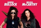Sandra Bullock and Melissa McCarthy in the UK promotional poster for The Heat.