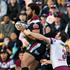 Manu Vatuvei and Manly Sea Eagles captain Jamie Lyon fight for a high ball. Photo / Greg Bowker
