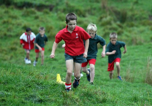 The East Coast Cluster Cross Country Trial 2013 made up of Tinui, Whareama, Mauriceville and Wainuioru schools at Tinui School. Organised for the 6 th year by acting Tinui principal Grant Zouch. Jonty Maunsell, 8, of Tinui lead the race from start to fin