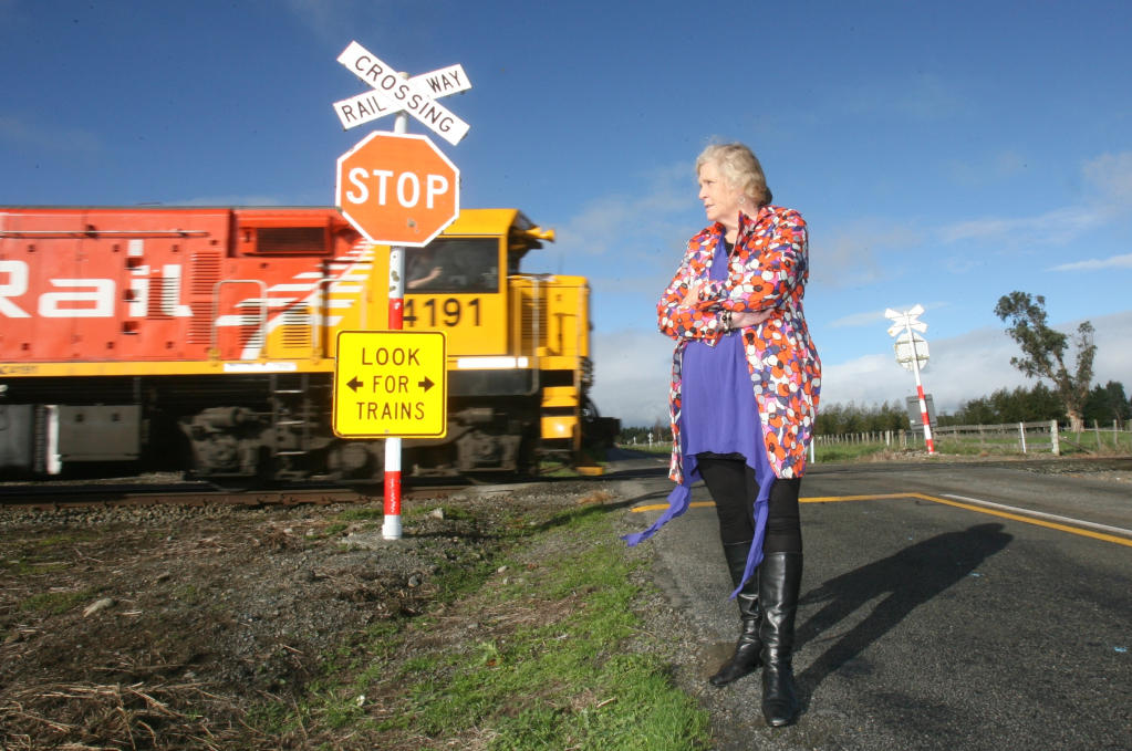 CHANGE: Janine Vollebregt stands by the uncontrolled Wiltons Rd railway crossing.