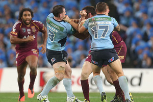 Paul Gallen of the Blues punches Nate Myles of the Maroons. Photo / Getty Images