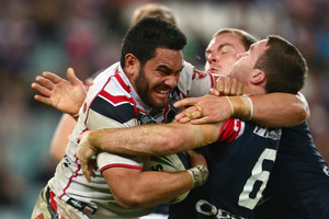 Konrad Hurrel makes a determined charge against the Roosters on Sunday. Photo / Getty Images