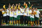 The Australian soccer team celebrate after qualifying for the 2014 FIFA World Cup. Photo / Getty Images