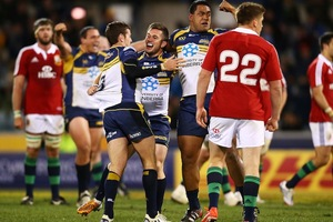 Members of the Brumbies squad celebrate a historic win over the Lions. Photo / Getty images