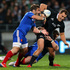 Israel Dagg of the All Blacks is tackled by Marc Andreu of France during the third test match between the All Blacks and France. Photo / Getty Images