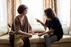 Director Dana Rotberg (right) speaks with Antonia Prebble on the set of <i>White Lies</i>.
