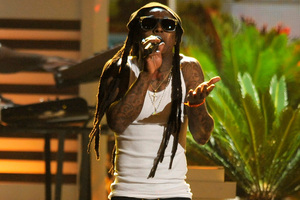 Lil Wayne is raising eyebrows over his treatment of the American flag. Photo / AP