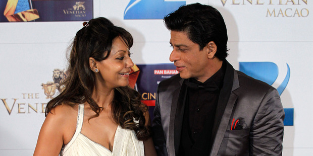 Shah Rukh Khan and his wife Gauri are being investigated over claims they know the sex of their unborn baby. Photo / AP