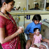 A young Indian child, in a pink shirt, undergoes treatment for encephalitis at a hospital in Gorakhpur in Uttar Pradesh state, India. Photo / AP