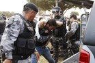 Riot police arrest a protester during a rally near Brasilia's Estadio Nacional Mane Garrincha to protest against the allocation of funds towards next year's World Cup. Photo / AP