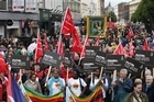 Thousands of people from trade unionists to gay and lesbian activists braved the rainy weather to march through the streets of Belfast to voice their anger ahead of the G8 summit which starts in Northern Ireland on Monday.