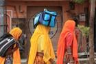 Devout pilgrims walk long distances to important temples. Photo / Paul Rush