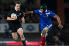 Ben Smith fly's past French flanker Thierry Dusautoir. Photo / Getty Images