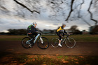 Rachel Grunwell, left, tackles a cycle challenge with cancer survivor Karen Shelton through Victoria Park. Photo / Getty Images