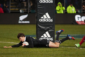 Taranaki's Beauden Barrett scores the second of the All Blacks' outstanding tries in Christchurch on Saturday night. Photo / Getty Images