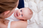 The book says eye contact is vital and urges parents to describe out loud what their baby is doing. Photo / Getty Images